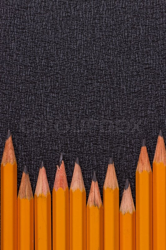 Stock image of 'set of pencils on black background, closeup, macro'