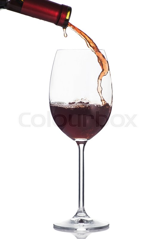 Stock image of 'Red wine poured into a glass isolated on white background'