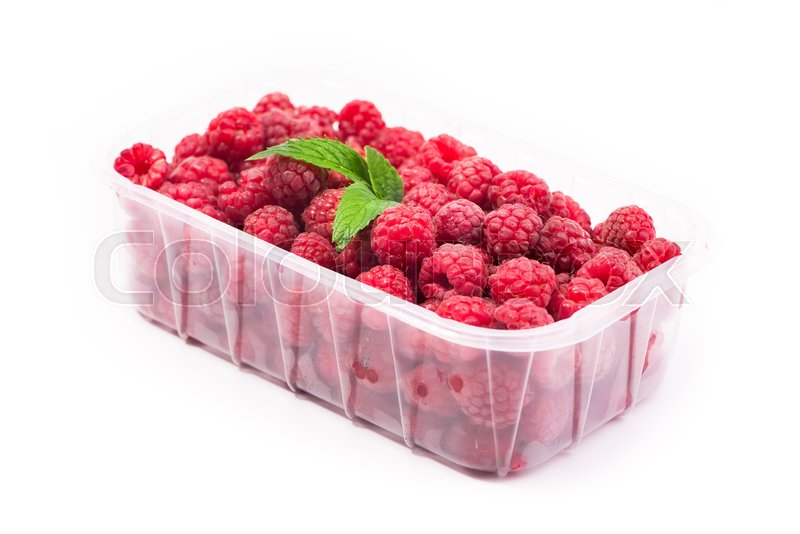 Stock image of 'Red fresh raspberry in basket isolated on white background'