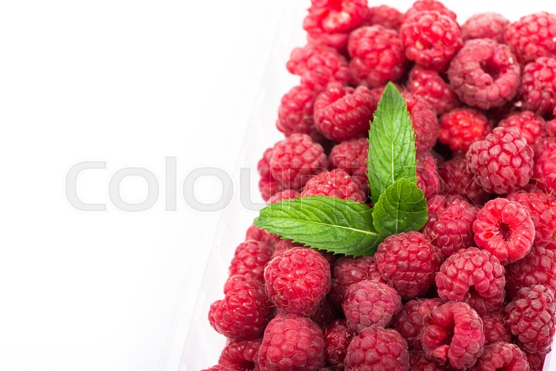 Stock image of 'fresh red raspberry wuth green leaf isolated on white background'