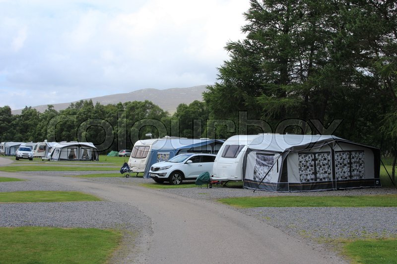 Stock image of 'Blue sky with clouds and a camping site at the Highlands at the village Braemar in Scotland in the summer.'