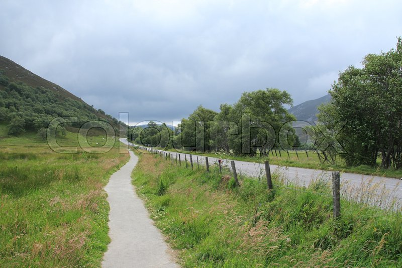 Stock image of 'Country road along the highway in the Highlands at the village Braemar in Scotland in the summer.'