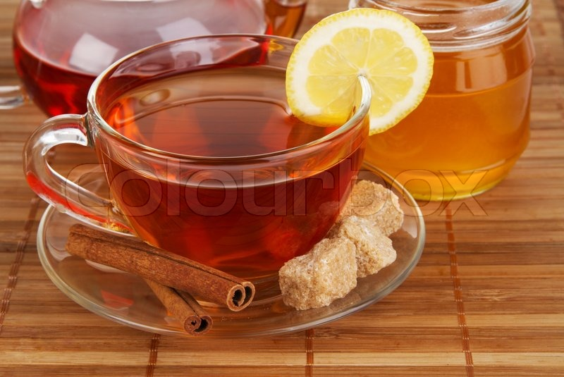 Stock image of 'Tea with honey, lemon and cinnamon'