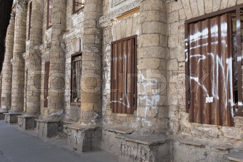 Stock image of 'Ancient facade of abandoned building. Photo can be used as a whole background.'