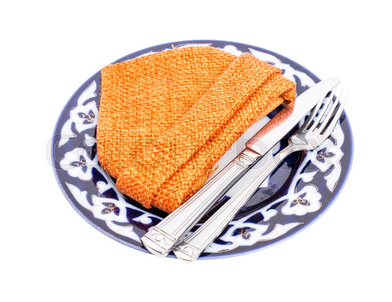 Stock image of 'Plate with fork and knife. Served with orange cotton napkin. Isolated on a white background.'
