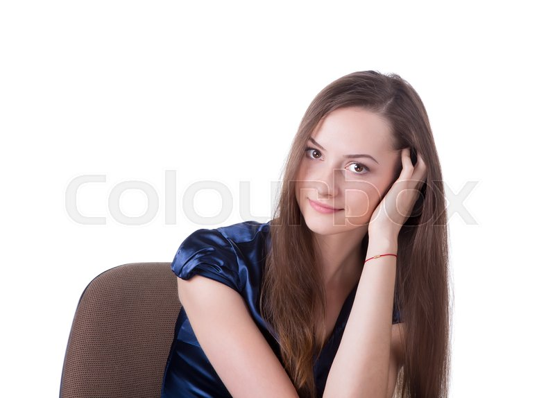 Stock image of 'Headshot of a brown hair lady sitting in a chair.'