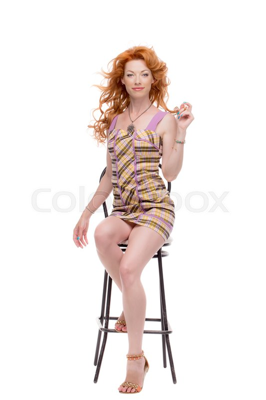 Stock image of 'Fulllength shot of redhead in a chair.'