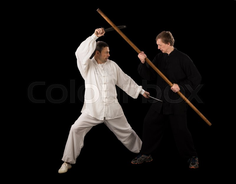 Stock image of 'Men fighting martial arts on a black background'