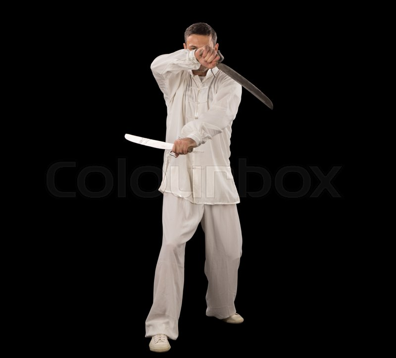 Stock image of 'Man in white spining swords on a black backgrownd.'