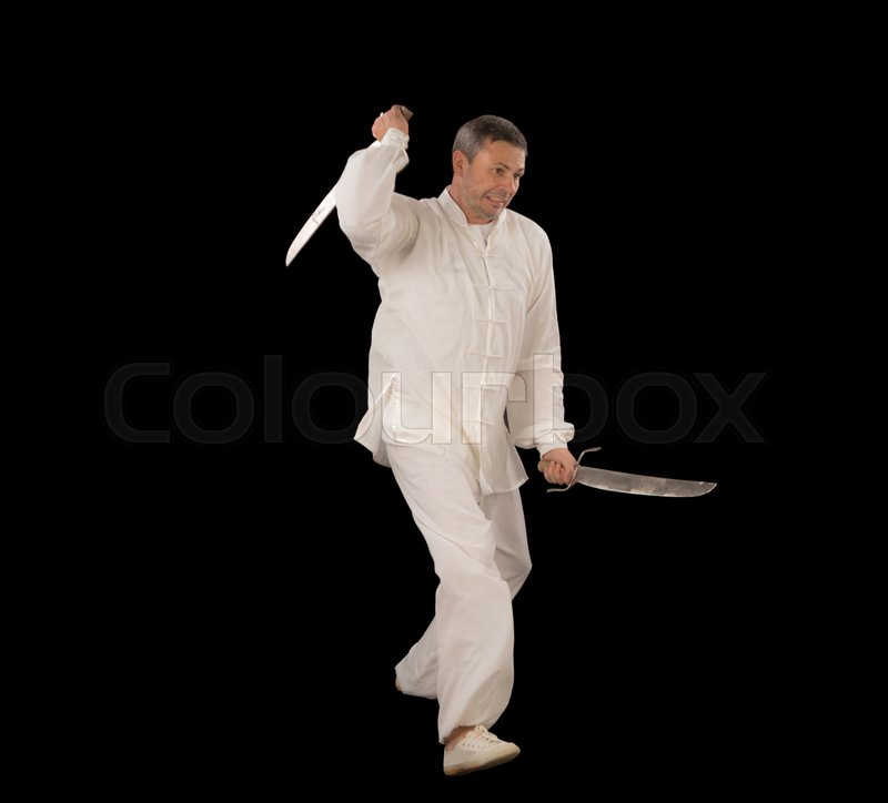 Stock image of 'Man wearing all white with two swords'