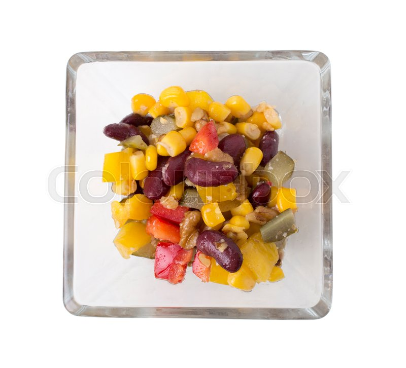 Stock image of 'Closeup of black bean and corn salad in a glass plate. Isolated on a white background.  '