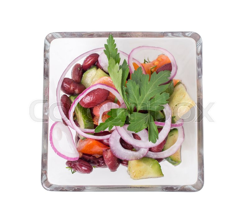 Stock image of 'Vegetable salad with red beans in a square glass bowl.  Isolated on a white background.'