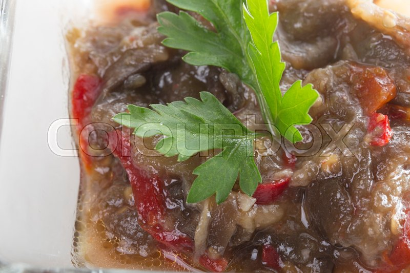 Stock image of 'Squash caviar with baked pepper in a square glass bowl.  Photo can be used as a whole background.'