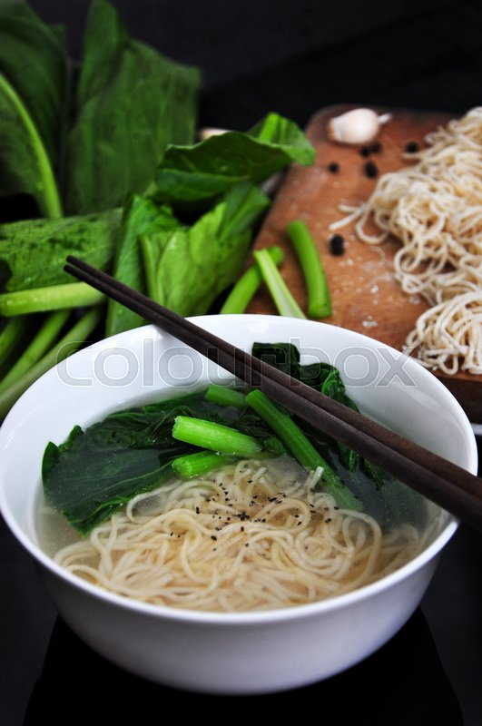 Stock image of 'Close up noodle bowl with fresh ingredients on background'
