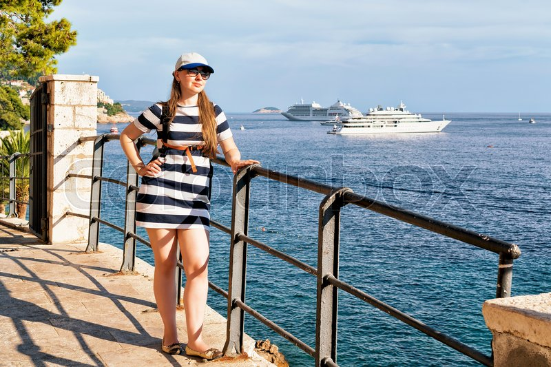 Stock image of 'Young woman at Adriatic Sea waterfront of Dubrovnik, Croatia'