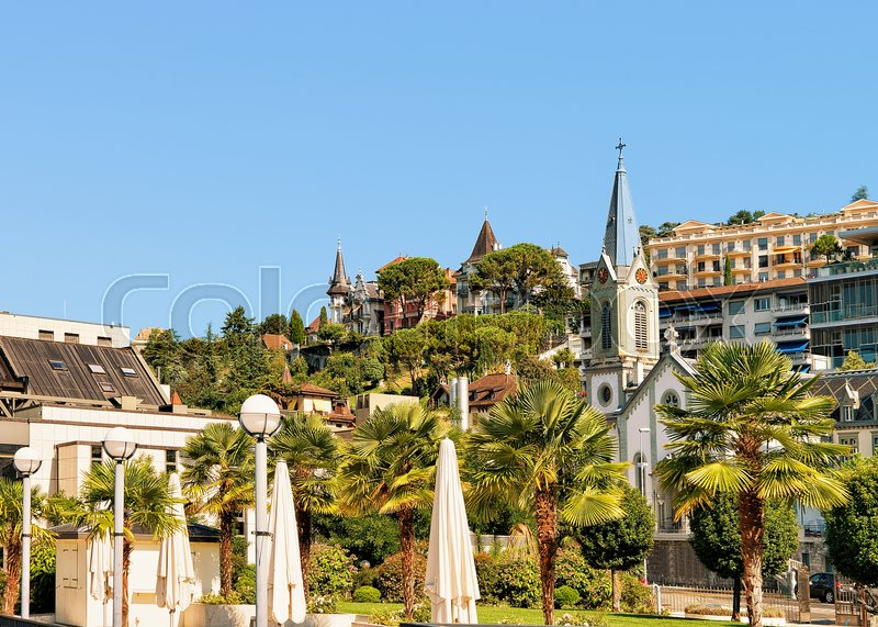 Church clock tower on Geneva Lake in Montreux, Swiss Riviera, stock photo
