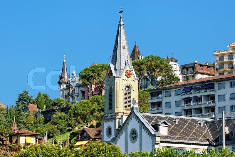 Church clock tower at Geneva Lake in Montreux, Swiss Riviera, stock photo