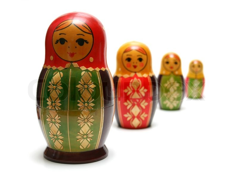 Traditional russian matreshka toys in a row, with focus on ...