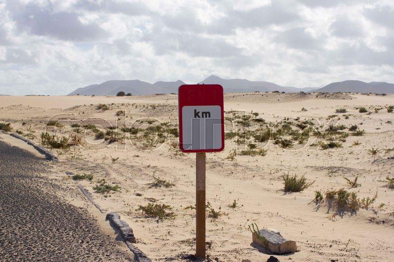 Blank road sign. Desert road. Asphalt prairie way. Square roadsign. Kilometres, stock photo