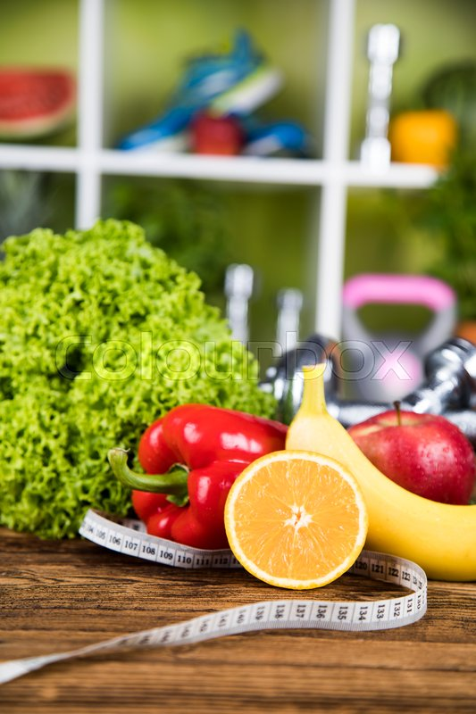 Fresh food and measure tape,Sport diet, stock photo
