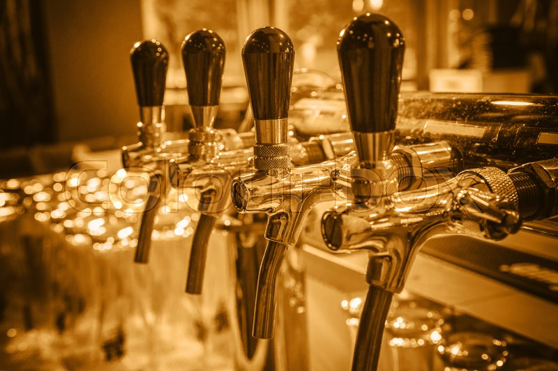 Chromed Taps For Draft Beer In A Modern Bar. Detail Of Beer Machine, Beer  Dispenser, Close Up, Selective Focus, Retro Style, Toning , Stock Photo