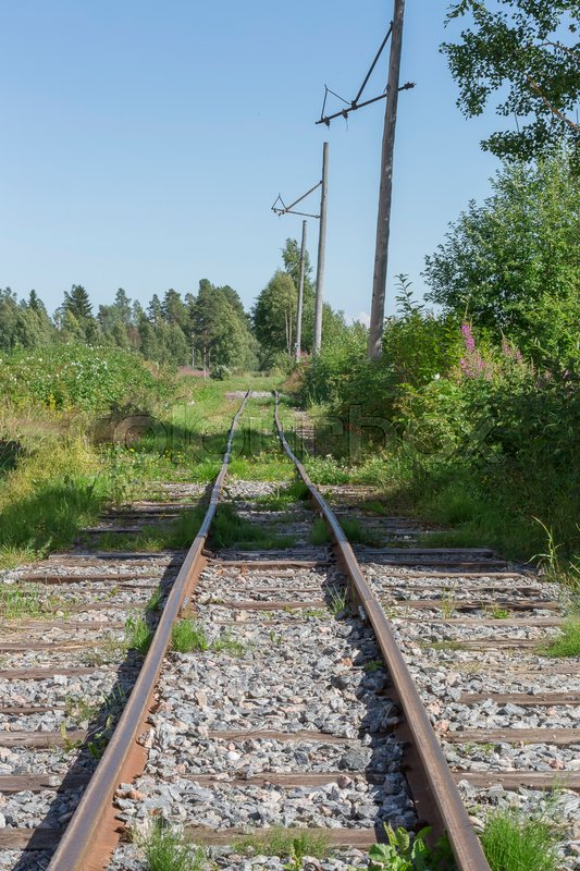 Old Railroad Tracks in nature with a blue sky, stock photo