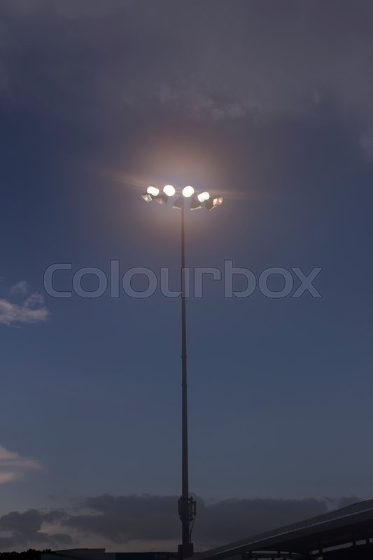 Spot light pole against white cloud and blue sky ; , stock photo