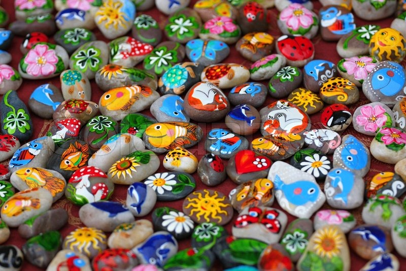 Stock image of 'Color images on the stones, symbols, characters and animals'