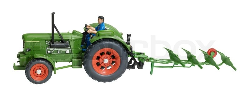 Nostalgie spielzeug traktor mit pflugschar stockfoto