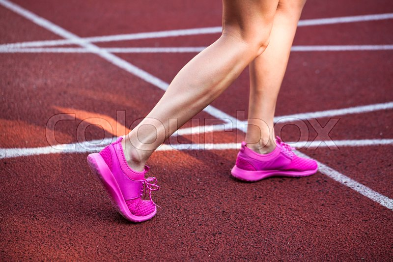 Sport backgrounds. Sprinter starting on the running track. Dramatic image, stock photo