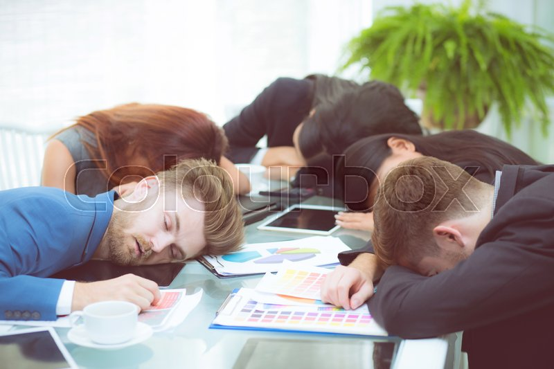bored business people sleeping in a meeting colleague stock photo