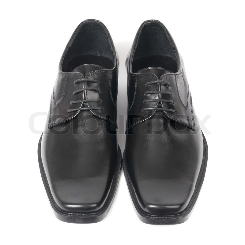 Stock image of pair of man s black shoes isolated on white background
