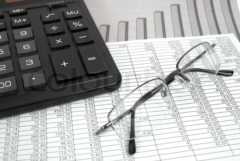 Pen and calculator on paper table with finance diagram | Stock ...