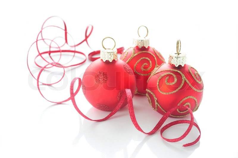 Three red Christmas ball ornaments with gold and with a red ribbon ...