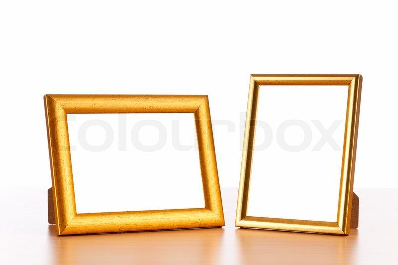 Photo frames on the table | Stock Photo | Colourbox