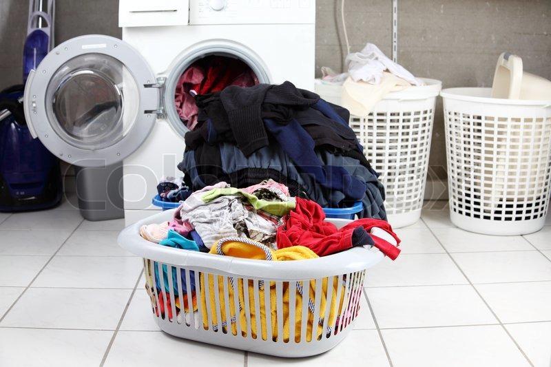 To kurve af beskidt vasketøj i ... | Stock foto | Colourbox