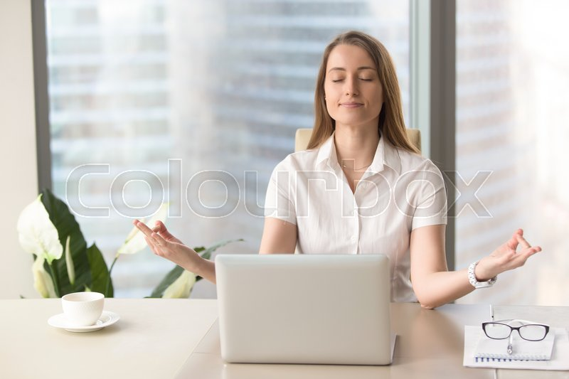 ... Peaceful Woman Enjoys Yoga With Eyes Closed At Desk, No Stress, Keep  Calm, Hands In Chin Mudra Gesture, Office Meditation, Portrait, Stock Photo