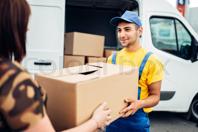 Cargo delivery service, male courier in     | Stock image
