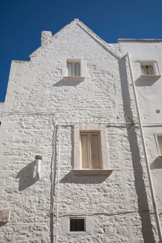 White painted building againt a nice blue September sky - Martina Franca, Apulia - Italy, stock photo