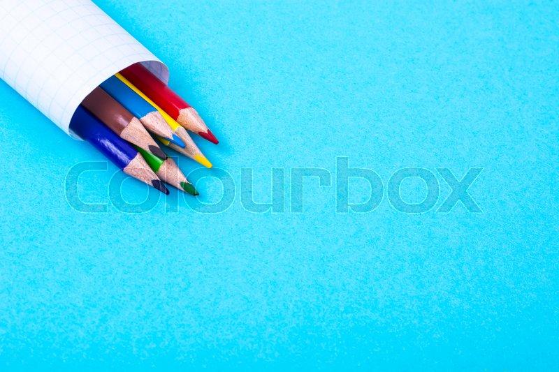 Colored pencils on bright pastel paper. Studio Photo , stock photo
