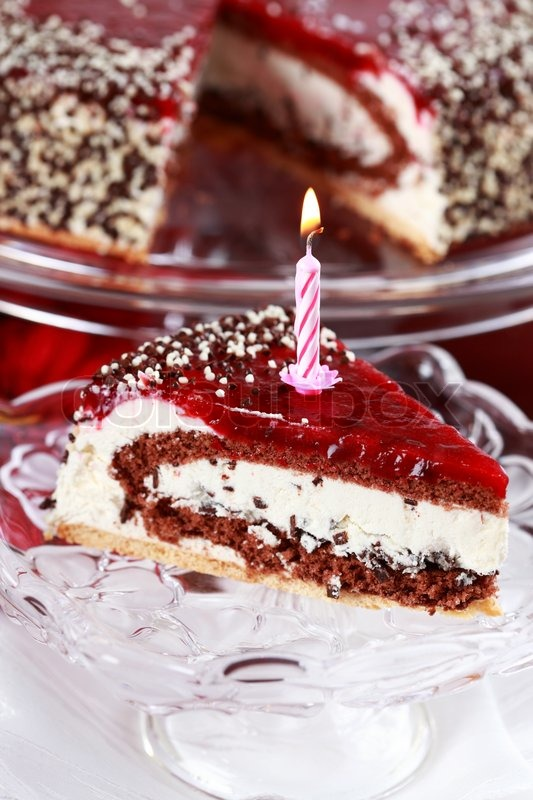 delicious stracciatella birthday cake with candle stock