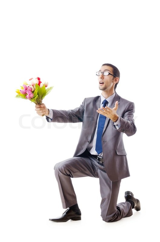 Stock image of 'Businessman offering tulip flowers'