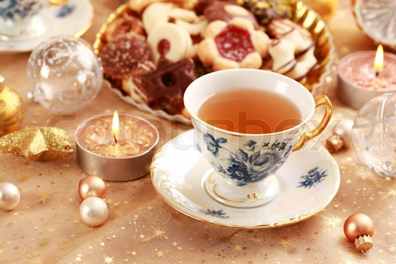 Tea For Christmas With Sweet Cookies With Candles In