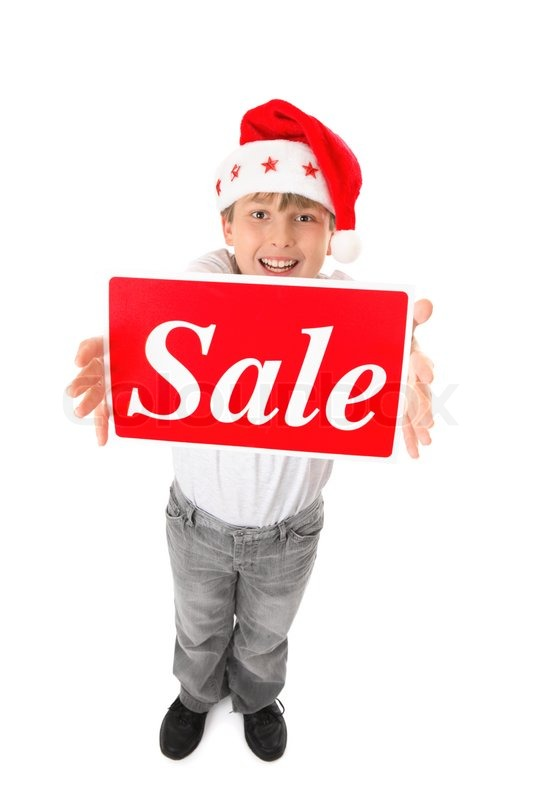 standing child holding a sale sign up high suitable for pre or post christmas sales stock. Black Bedroom Furniture Sets. Home Design Ideas