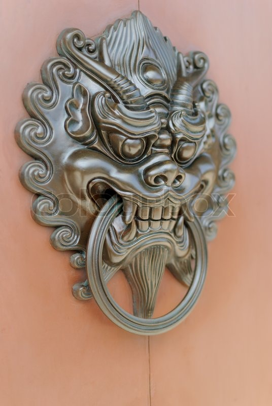 Stock image of 'Chinese lion door knob facing right'