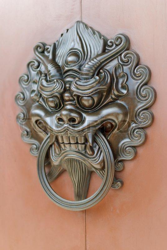 Chinese lion door knob facing left | Stock Photo | Colourbox