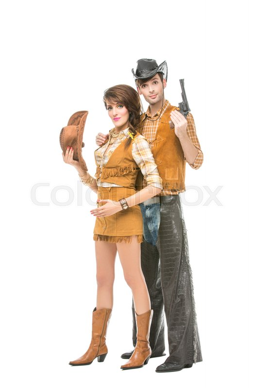 Stock image of 'beautiful young woman and man looking like dolls. Cowboy wih gun and cowgirl isolated on white background. Copy space.'