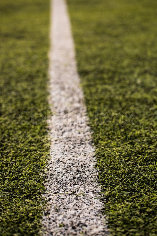 Green grass pattern for football sport, Football field, soccer field, team sport texture. White stripe on it. Close up focus, stock photo