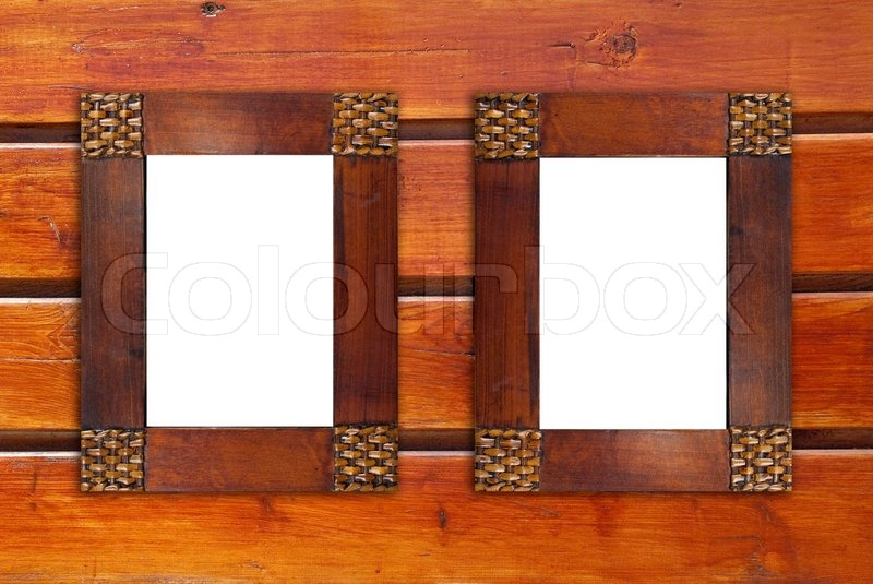 Two Blank Wooden Frames On Wooden Wall Stock Photo Colourbox