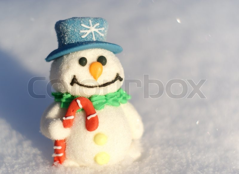 Little Christmas Snowman On The Snow White Background